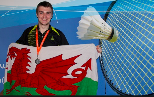 Jack Wilson holding welsh flag with medal round his neck